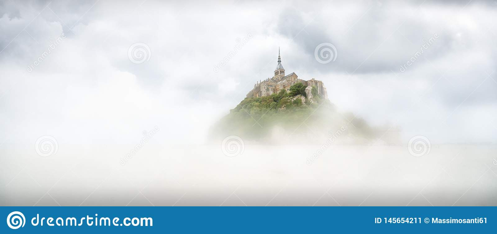 Panoramic view of the famous tidal island of Le Mont Saint-Michel on a fog day, Normandy, northern France