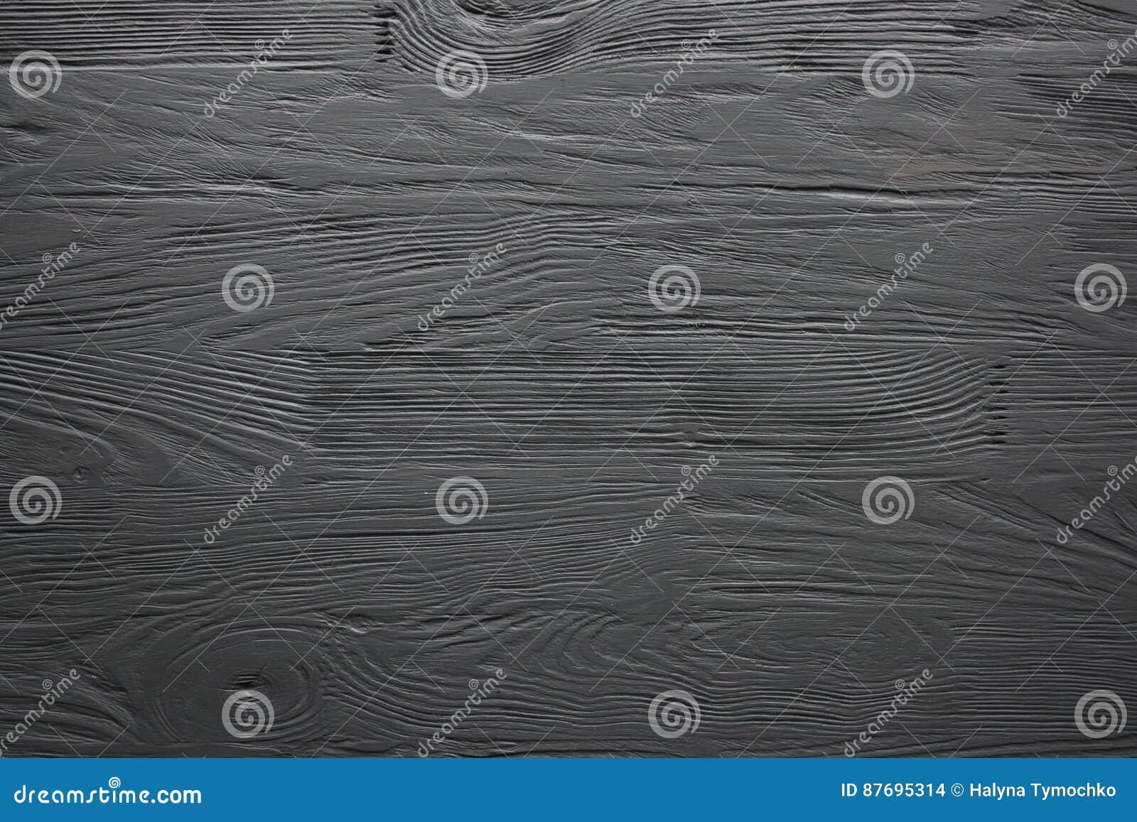 Le noir a peint la texture le fond et le papier peint en bois