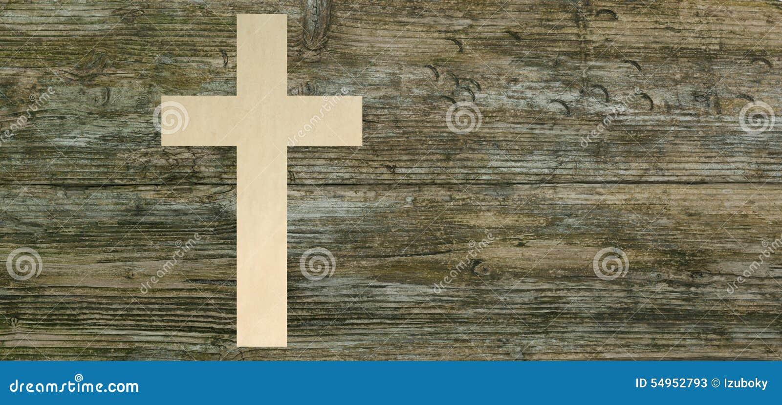 Le papier croisé chrétien a coupé le symbole en bois de christianisme de fond