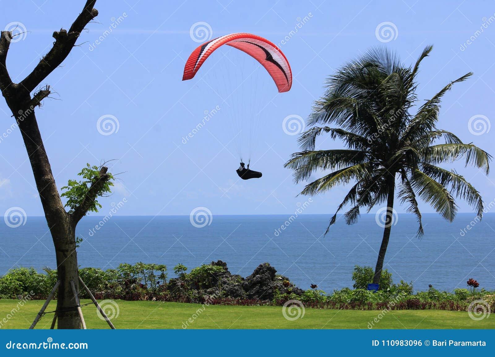 Le parapentiste préparent l atterrissage