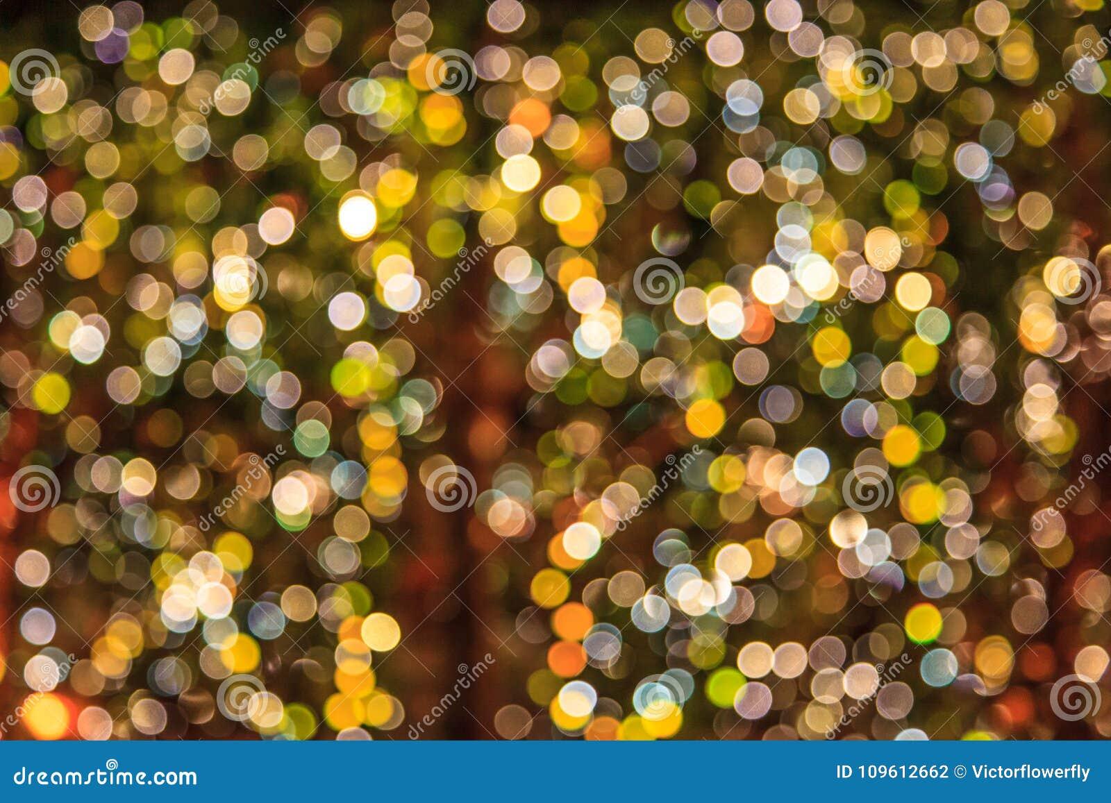 Le résumé a brouillé le fond brillant coloré éclatant d ampoules Les événements spéciaux, vacances, festivals wallpaper le dos de