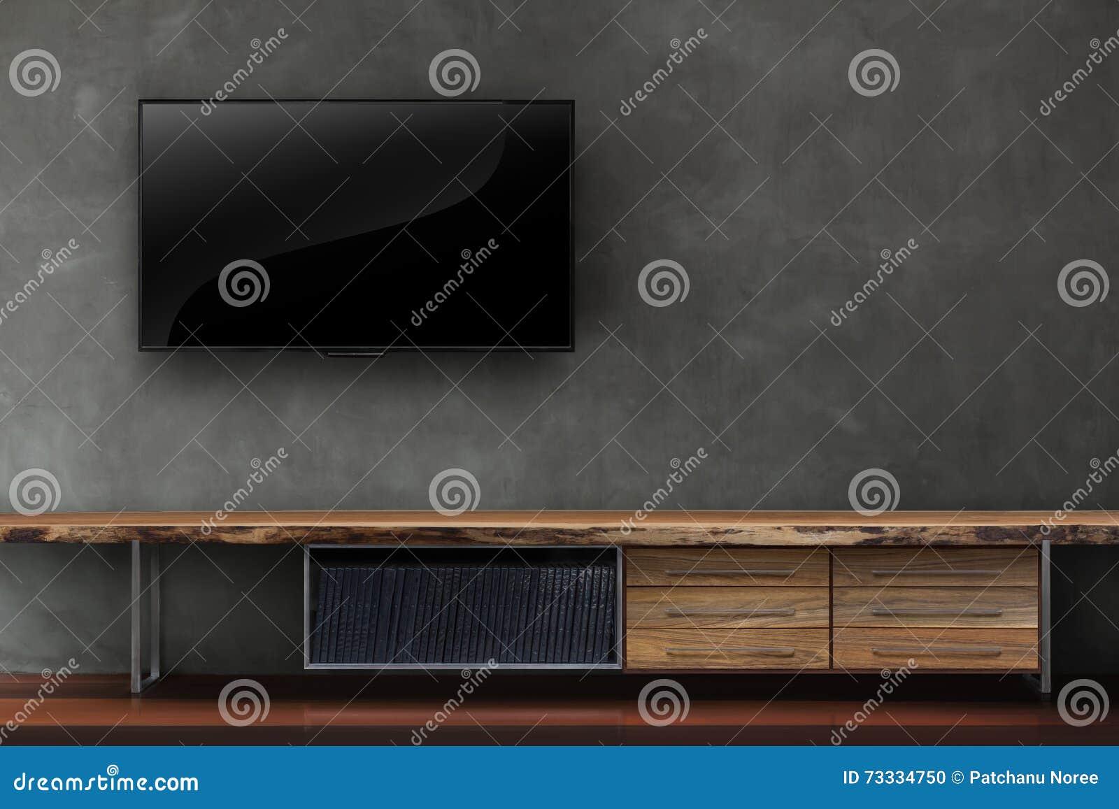Le salon a mené la TV sur le mur en béton avec le furn en bois de media de table