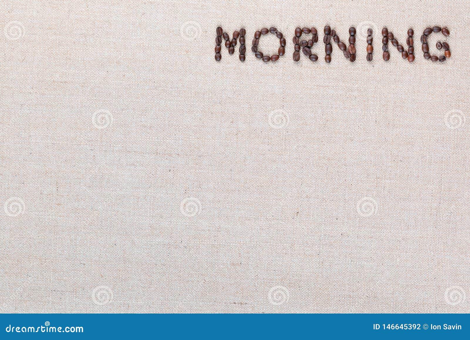 Le signe de lettre de matin des grains de café d isolement sur la texture de linea, a aligné en haut à droite