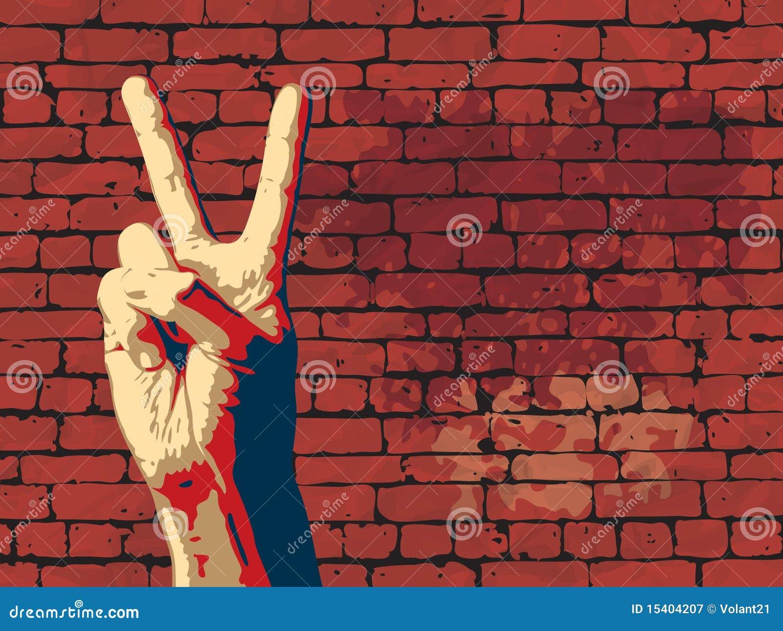 Le signe de victoire avec le fond rouge de mur de briques.