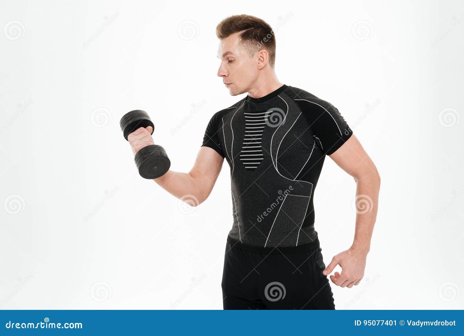Le sportif fort beau font des exercices de sports avec l haltère
