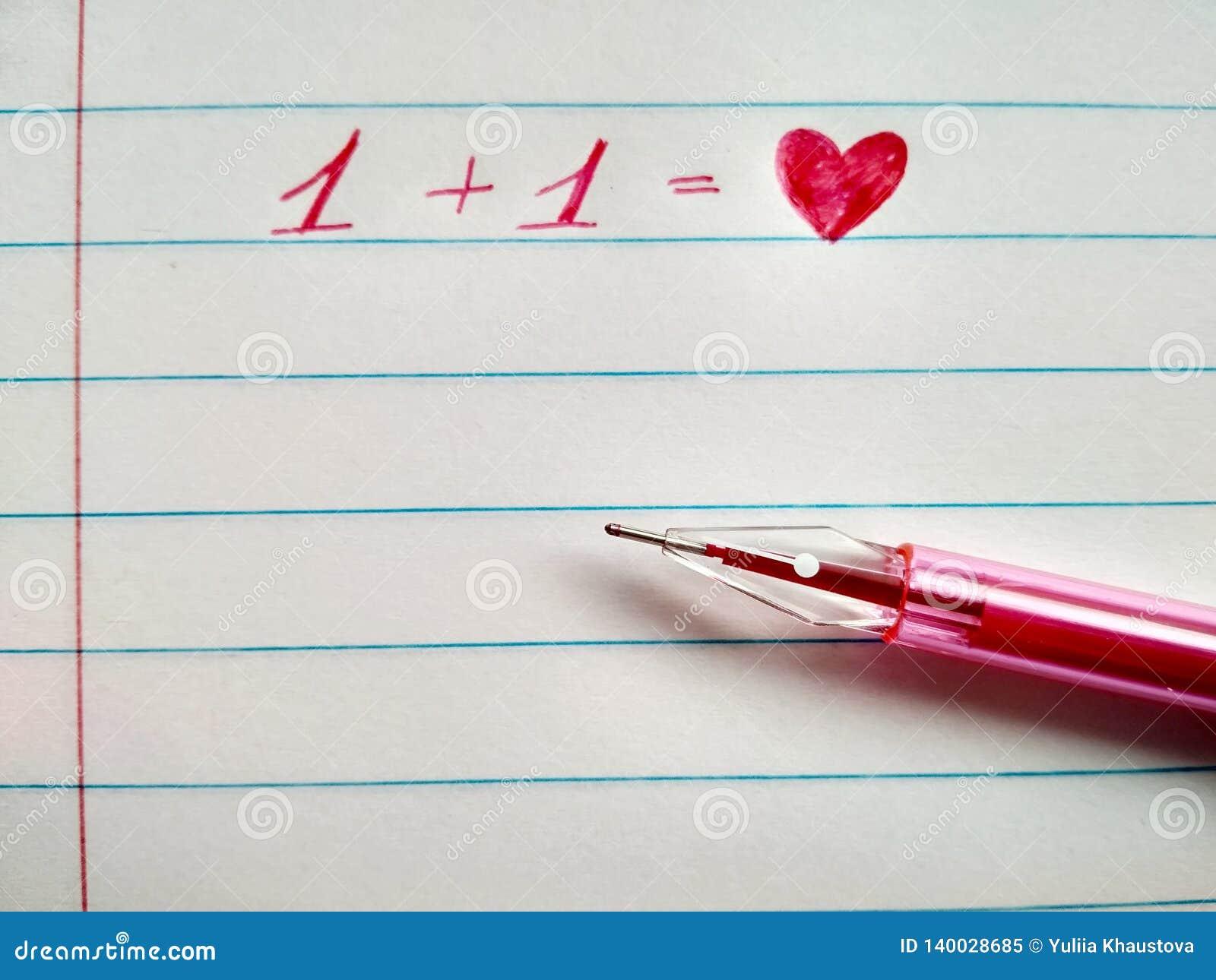 Le stylo et le coeur rouges de gel d inscription