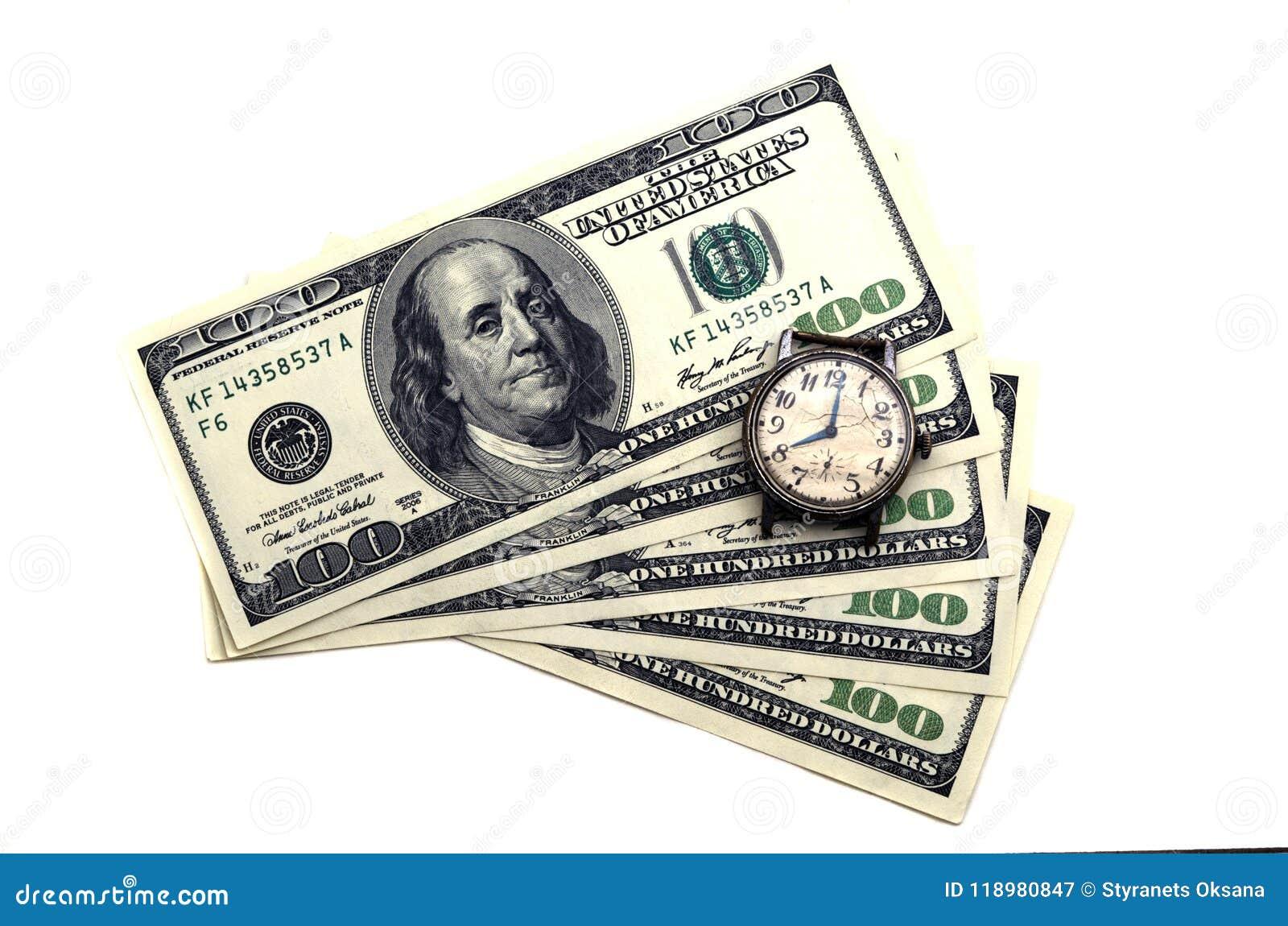 Le temps, c est de l argent Vieille horloge sur le fond de l argent
