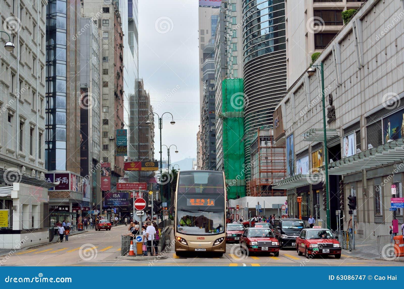 Download Le Trafic Et Les Gens Au Centre De Message Publicitaire De Hong Kong Photographie éditorial - Image du divers, asiatique: 63086747