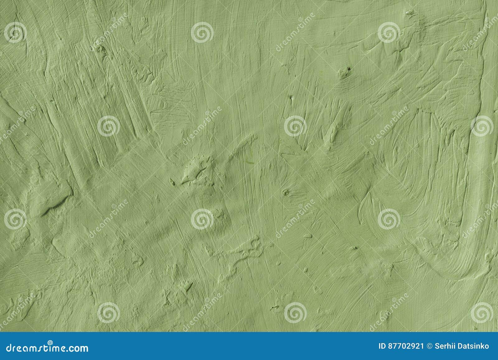 Le vert plâtré rocailleux superficiel par les agents a peint le fond extérieur de mur