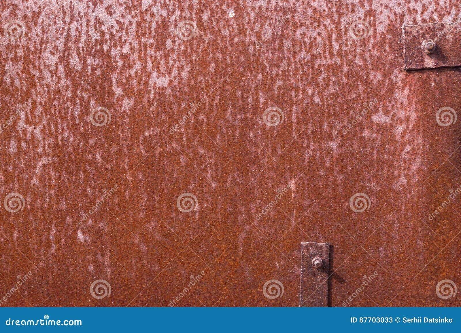 Le vieux fer grunge rouillé avec le métal rivette la texture