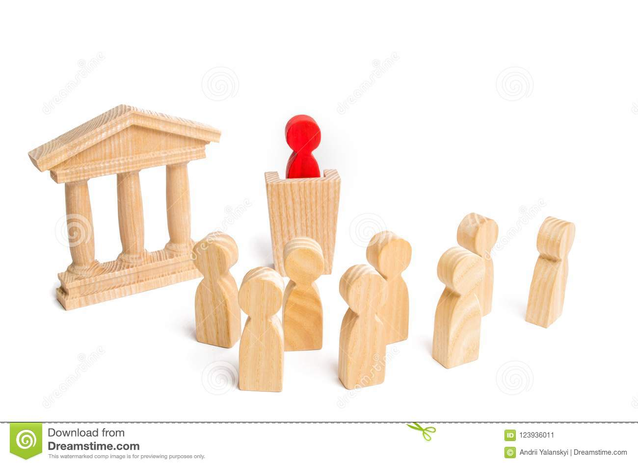 The leader from the rostrum speaks a speech addressing a crowd of people. Business concept of leader and leadership qualities, cro