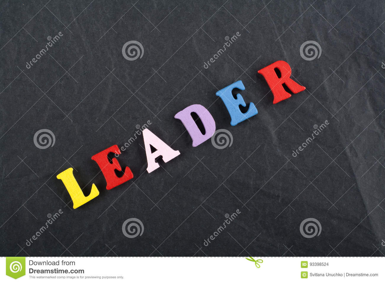 LEADER word on black board background composed from colorful abc alphabet block wooden letters, copy space for ad text