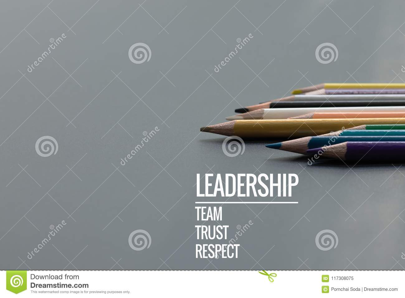 Leadership business concept. Gold color pencil lead other color with word Leadership, team, trust and respect on black background