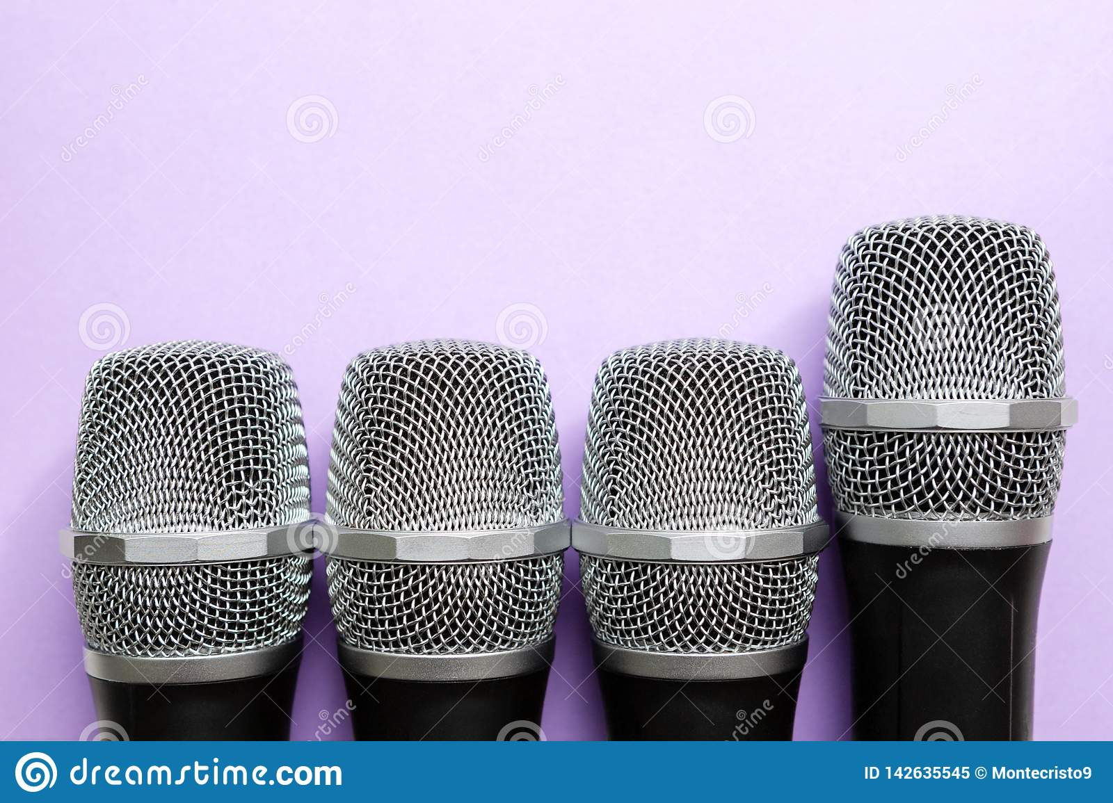 Leadership concept. group of microphones with golden one. freedom to speak up concept