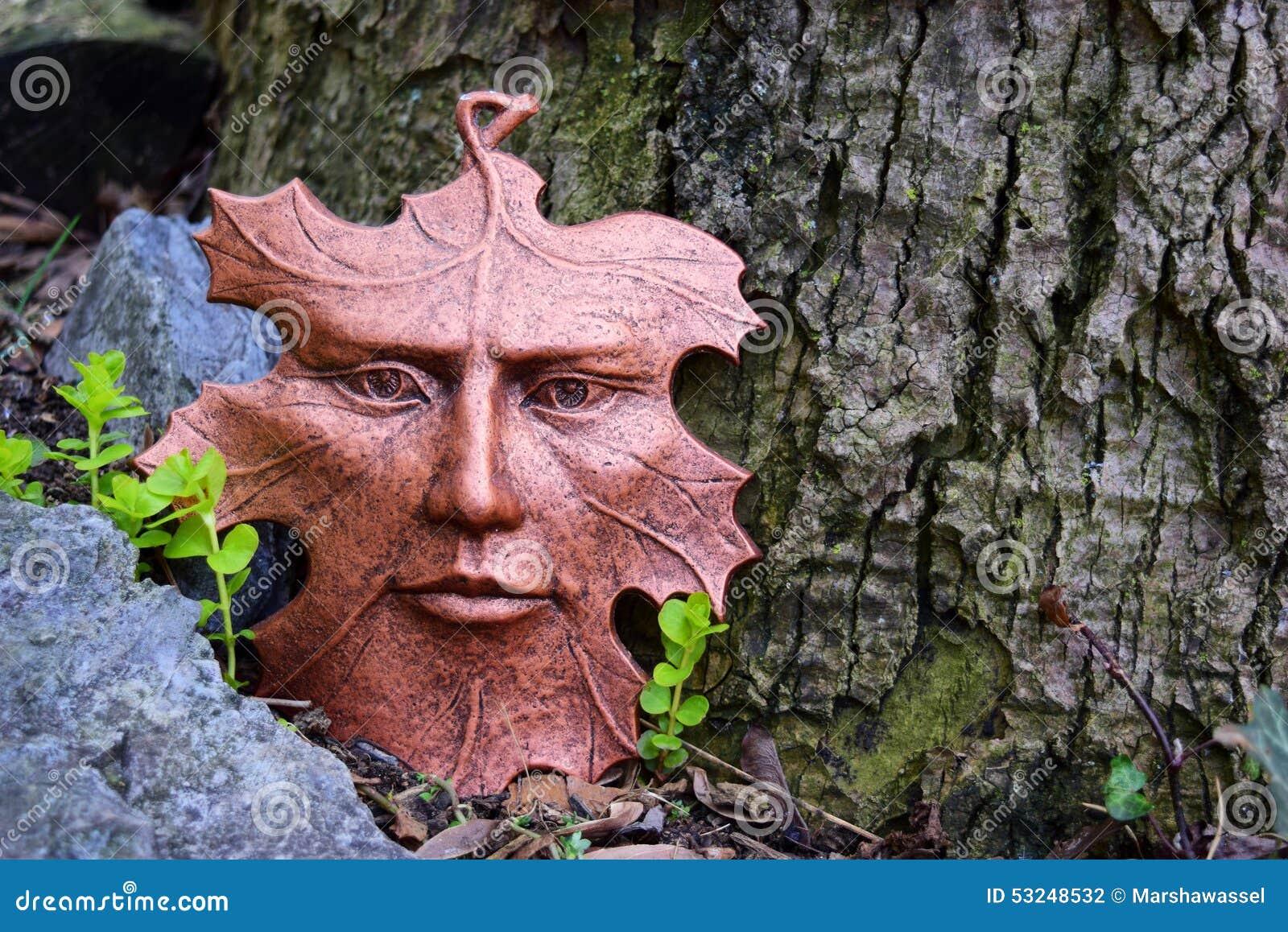 Leaf Face Sculpture In The Garden.