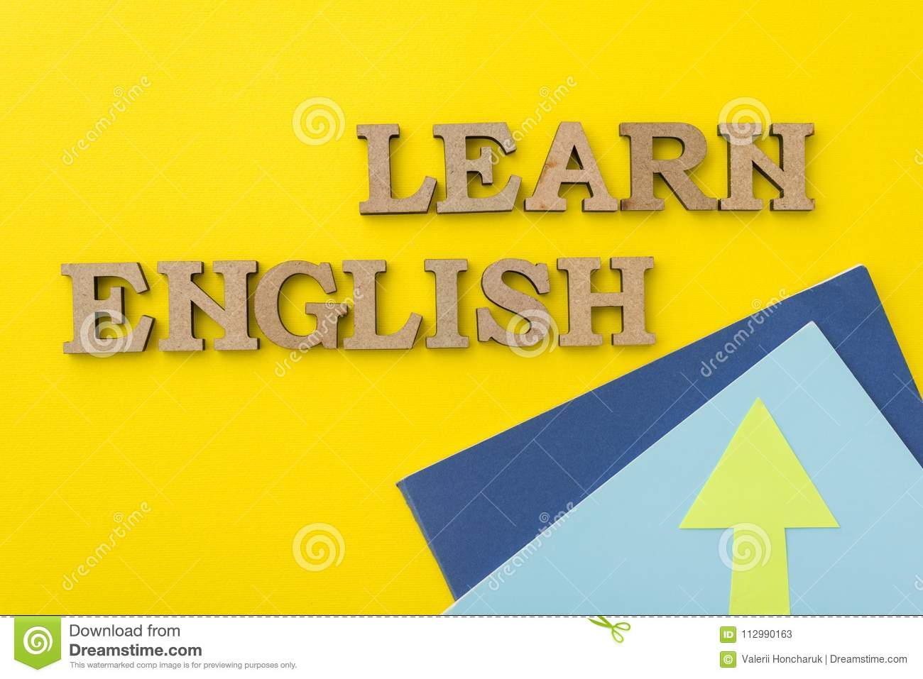 Learn English, words in wooden letters with yellow background