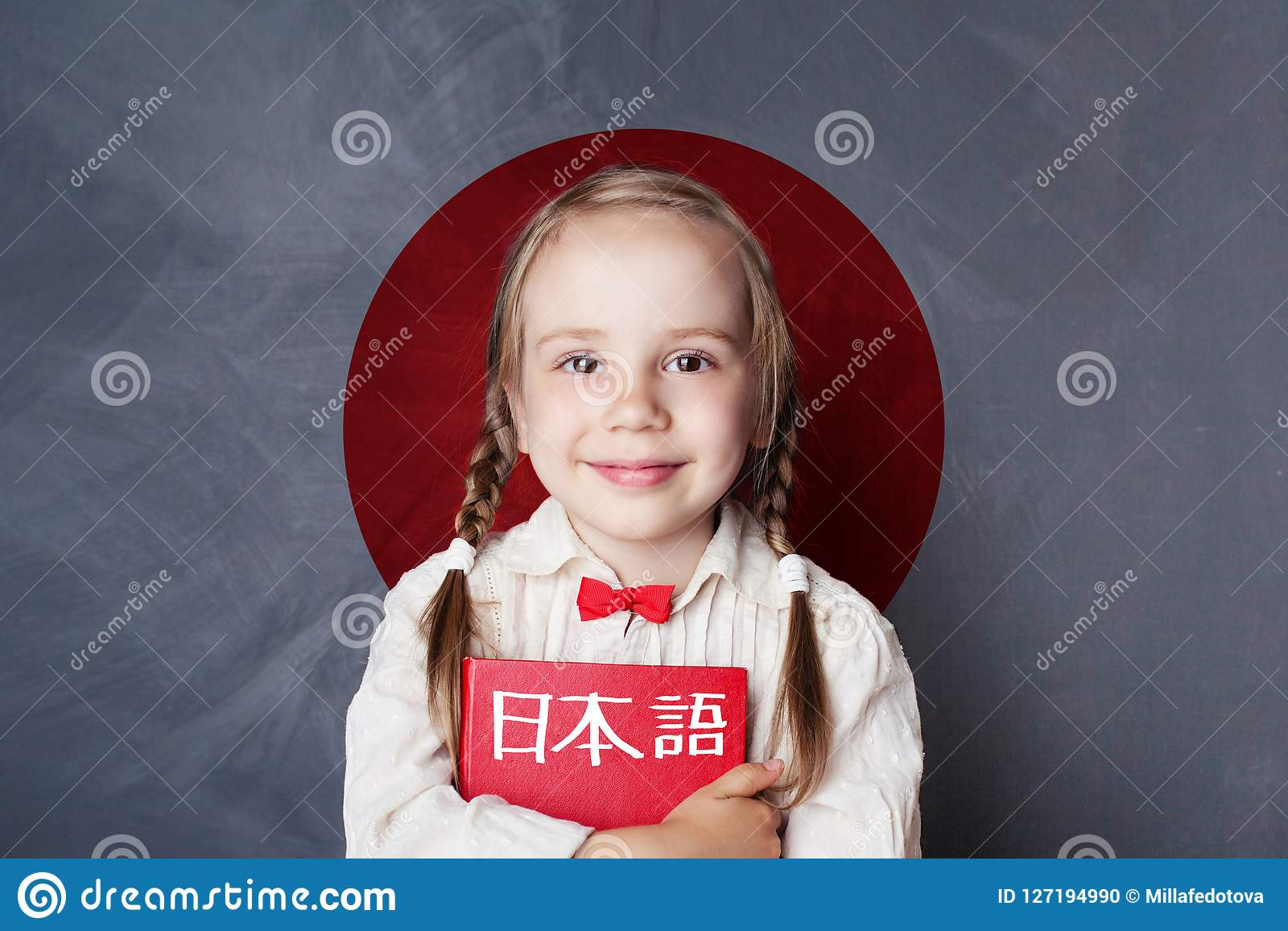 Learn japanese language. Smiling kid pupil on Japan flag