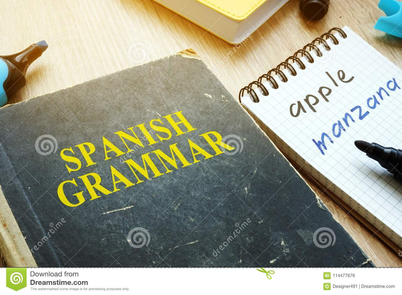 Learn Spanish Grammar  Book And Notebook On A Desk  Stock Photo