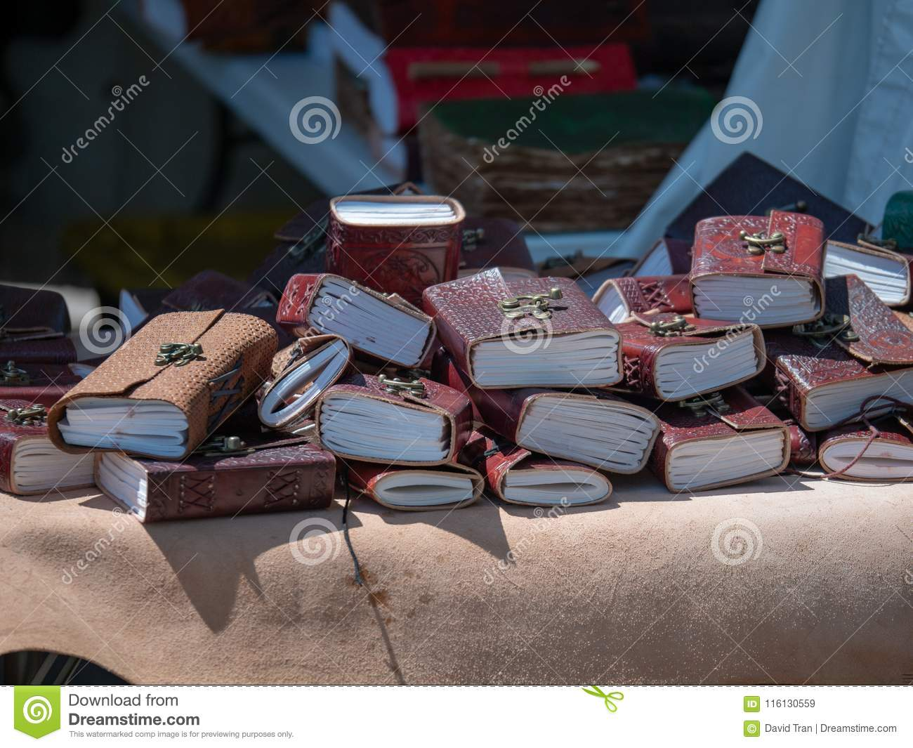 Leather bound decorative notebooks sitting in a pile