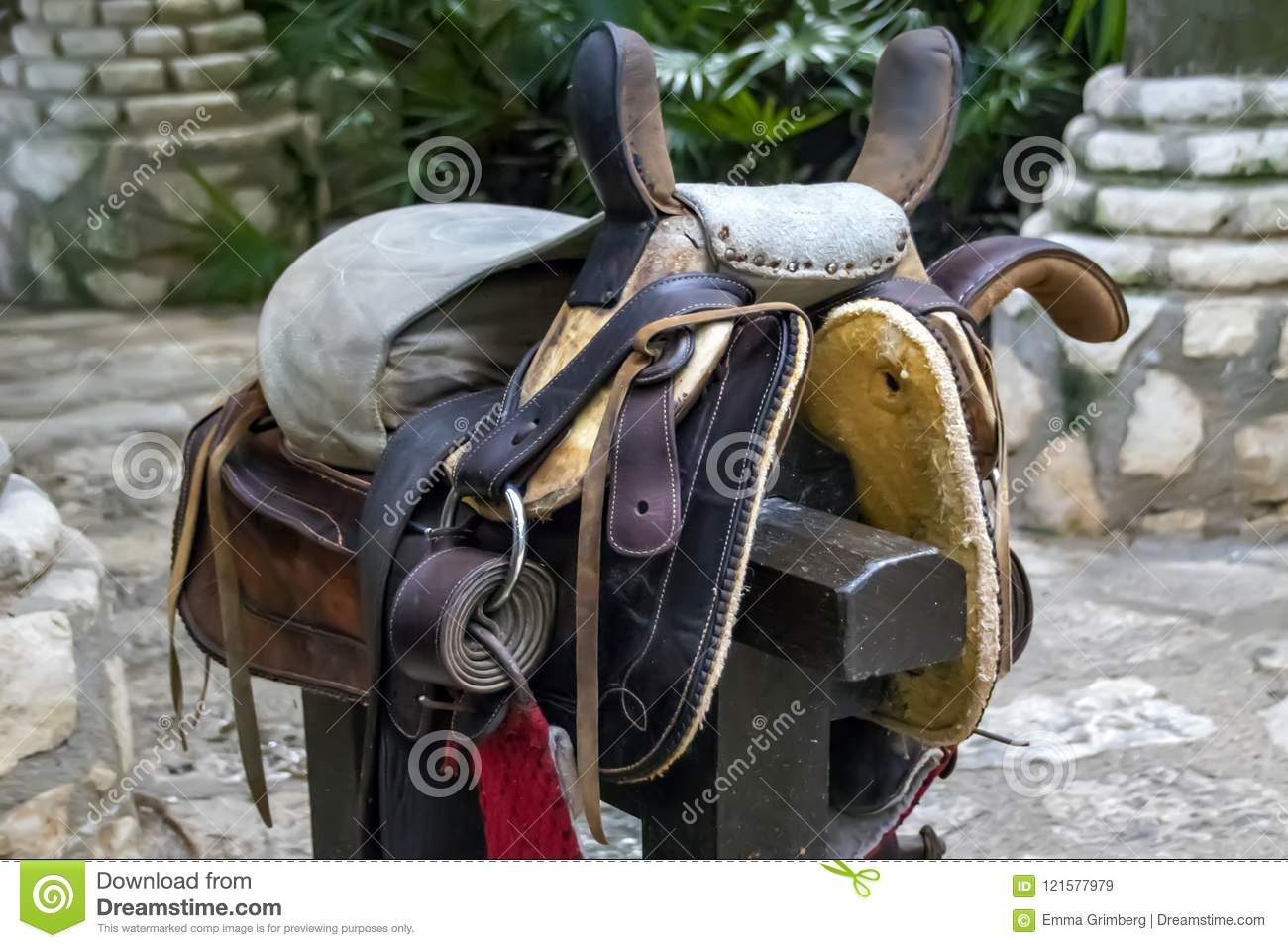 Leather horse harness on a wooden post