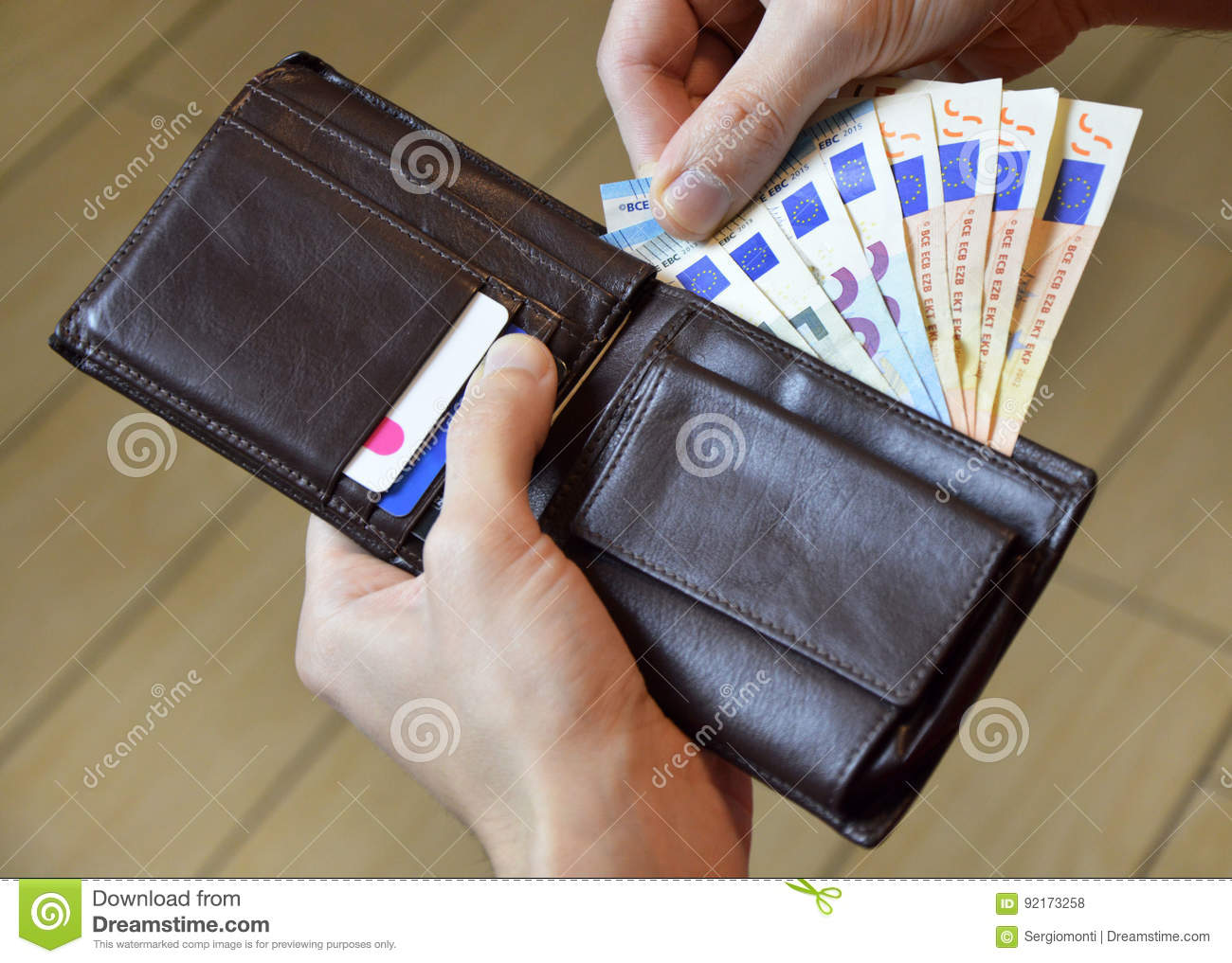 Leather wallet with money in male hands euro