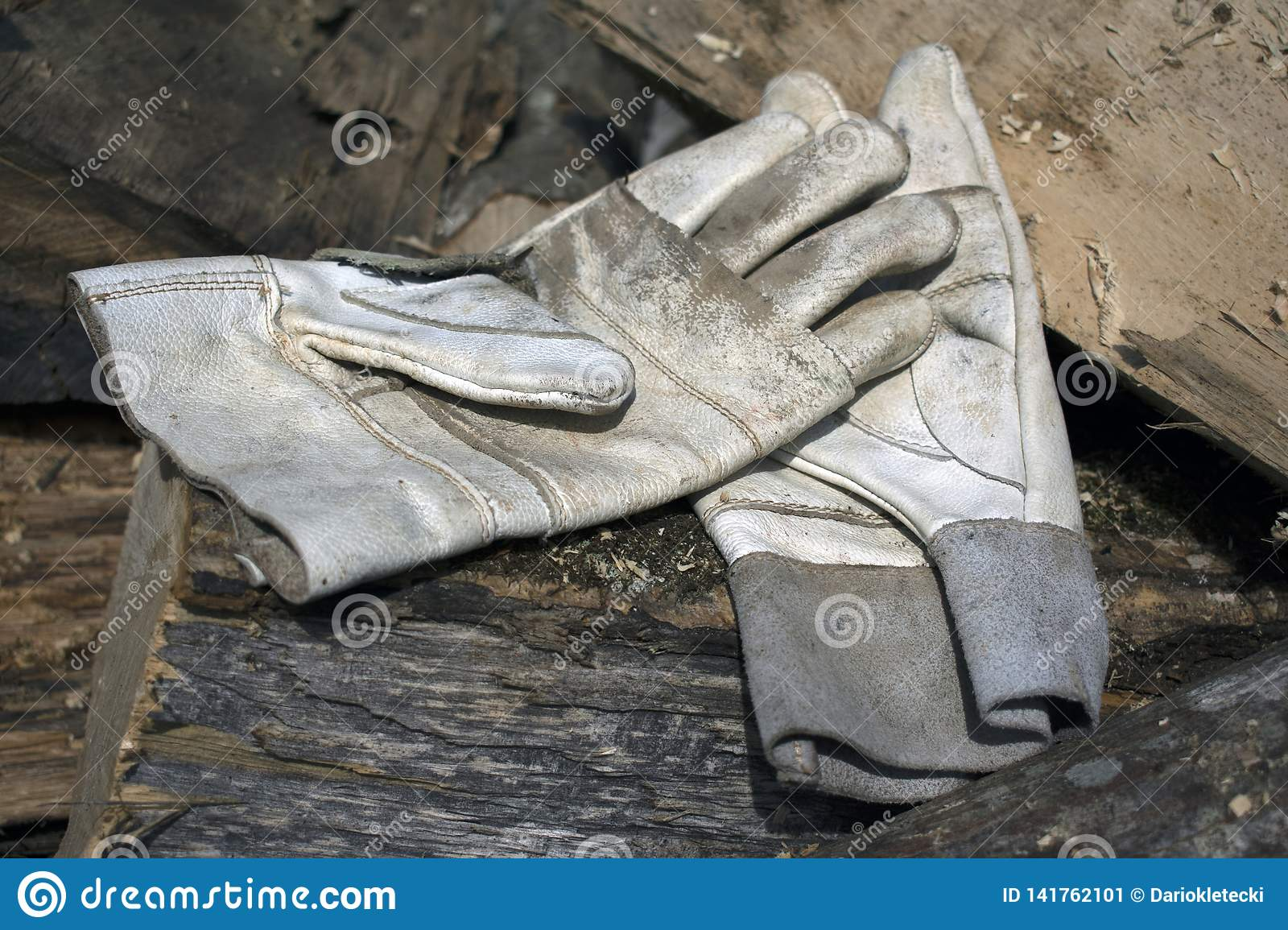 Leather working gloves on a pile of stumps