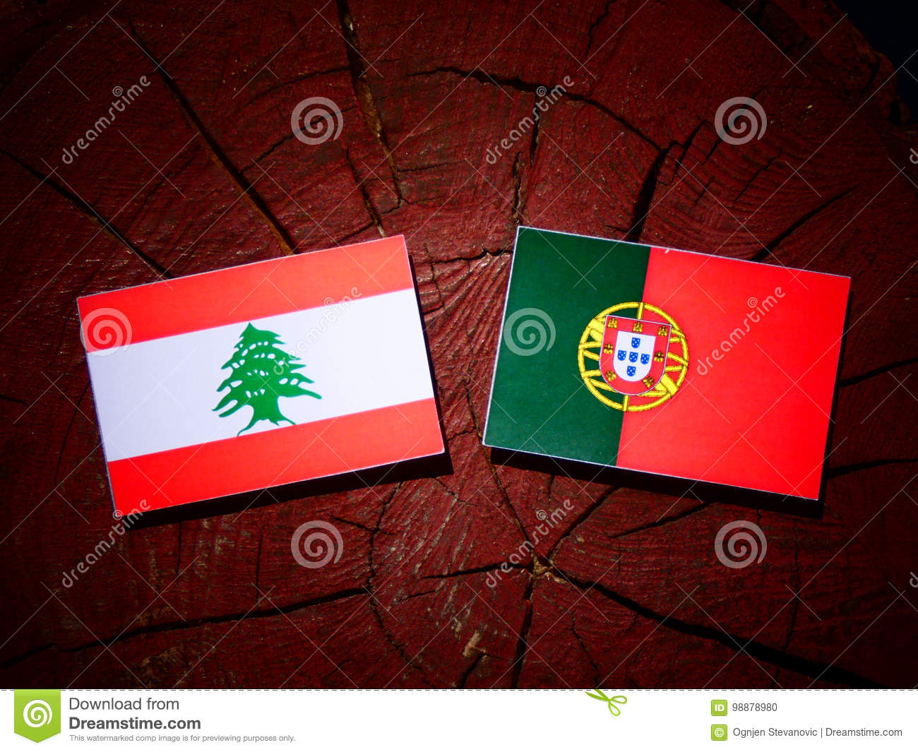 Lebanese flag with Portuguese flag on a tree stump isolated
