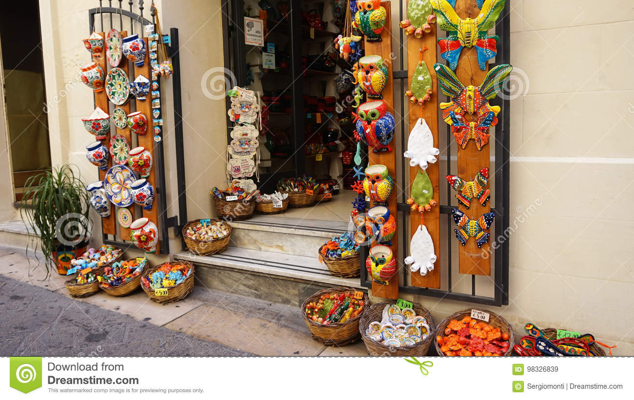 LECCE, ITALY - AUGUST 2, 2017: crafts souvenir store in old cozy street in Lecce, Italy. Architecture and landmark of Lecce, Italy