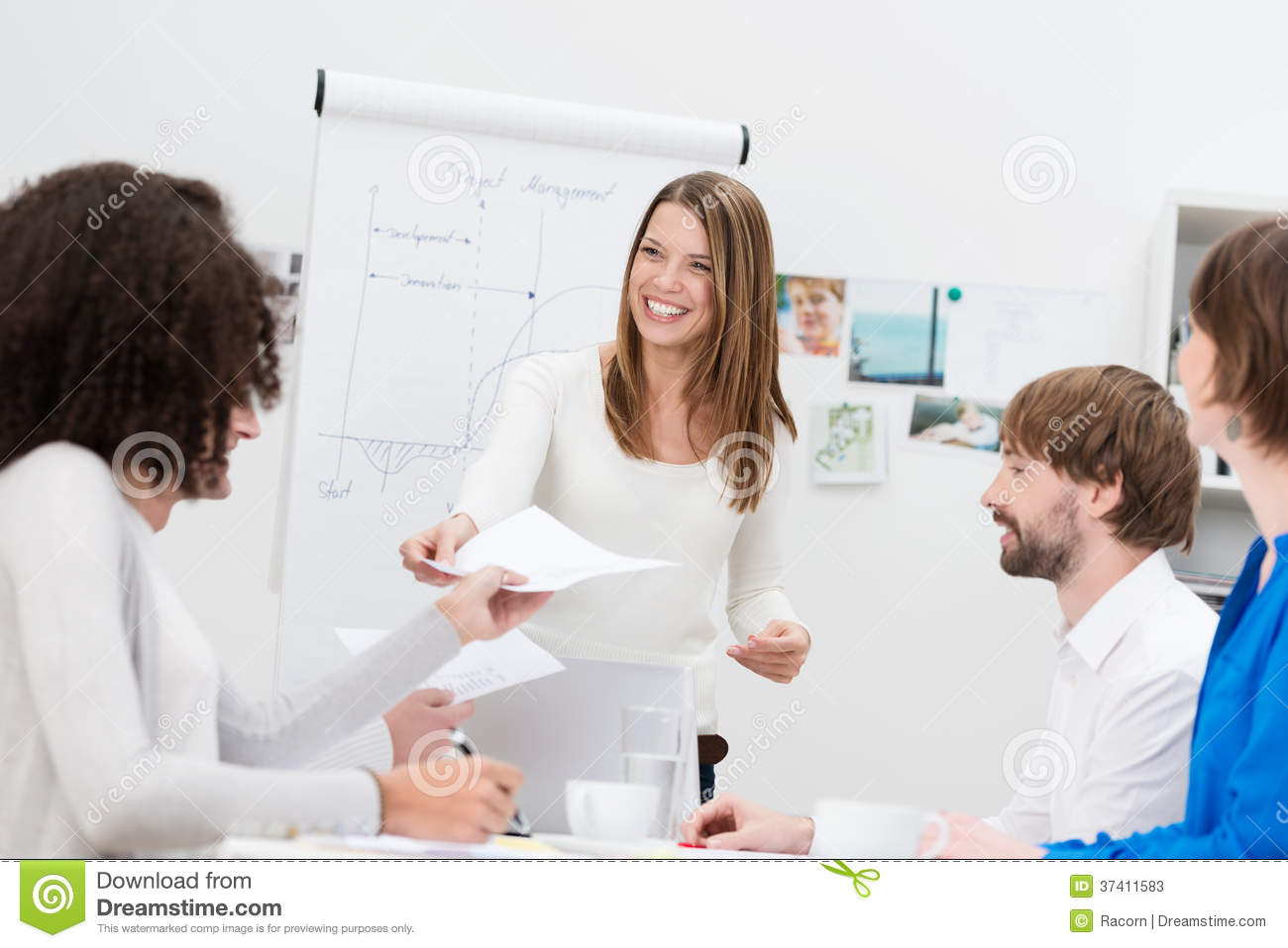 lecturer or in house trainer handing out notes stock image image