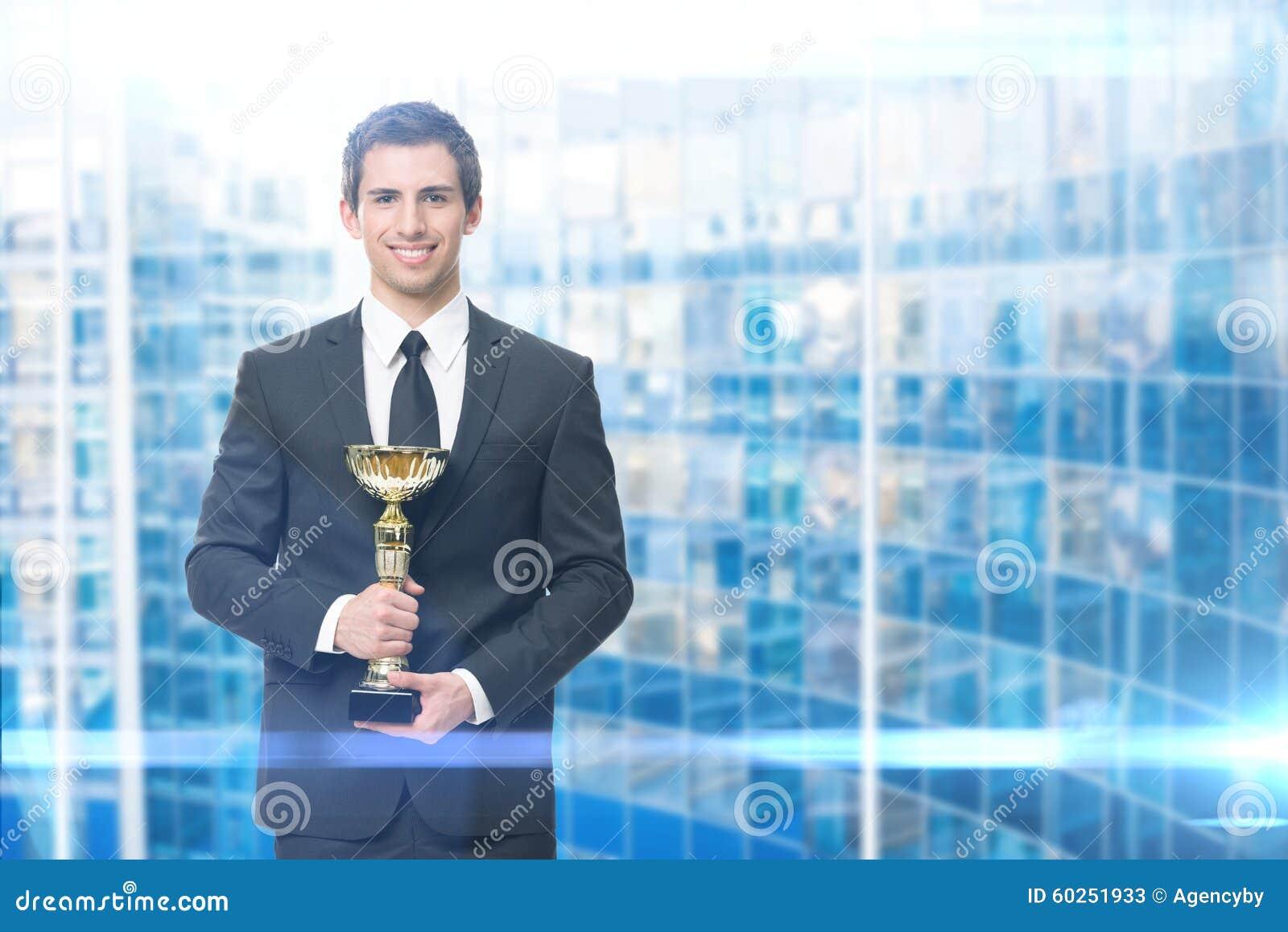Ledare med den guld- koppen