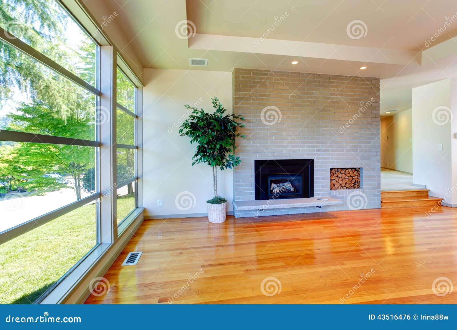 Leeg huisbinnenland de woonkamer van de glasmuur met bakstenen muur stock foto afbeelding - Muur van de ingang ...
