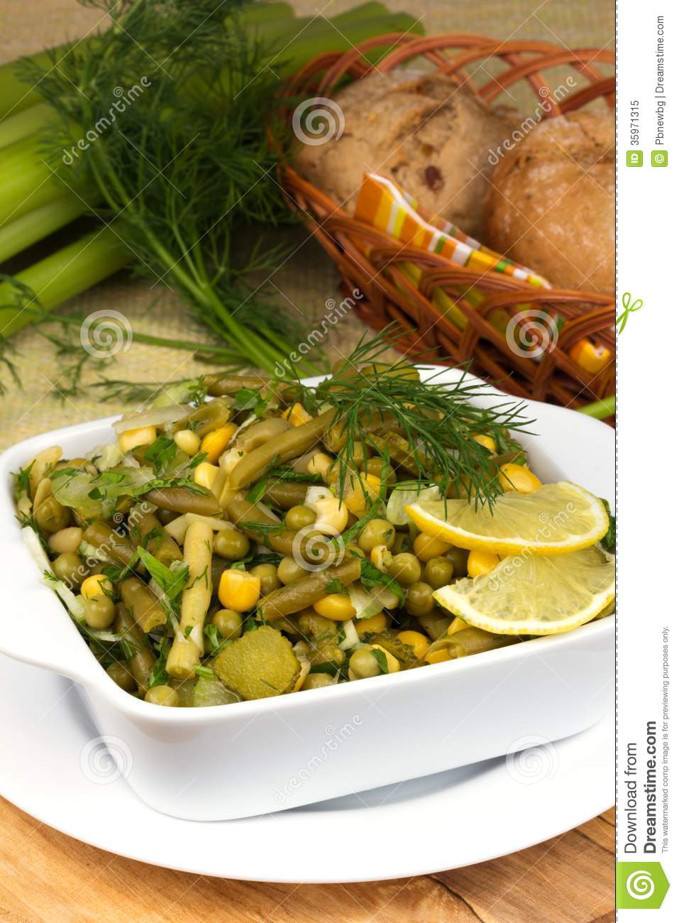 Salad of fresh leek with green peas and green beans, greens on a plate ...