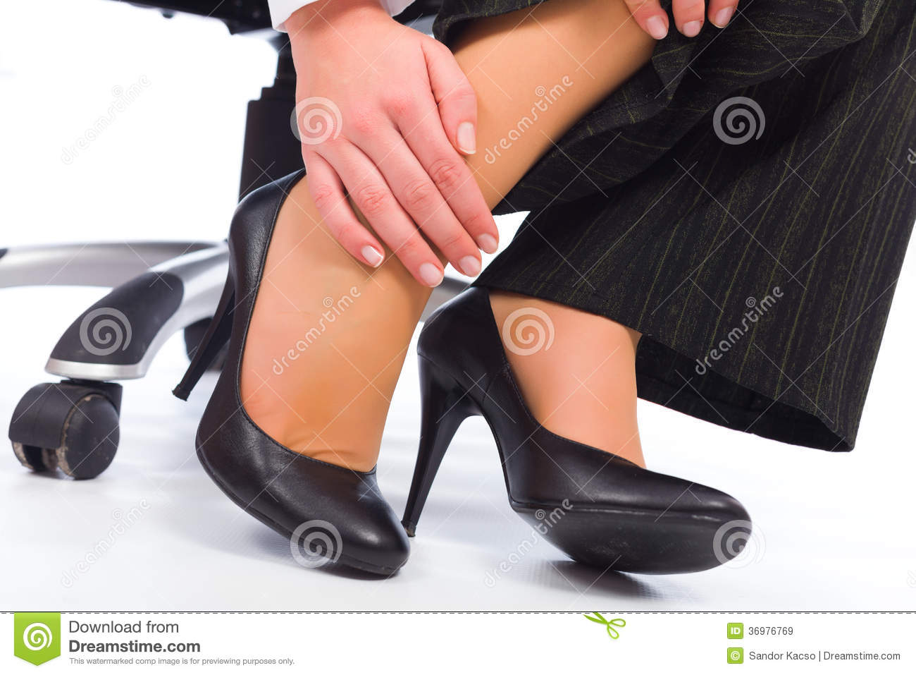 Massaging tired hurt leg due to wearing all day high heels.