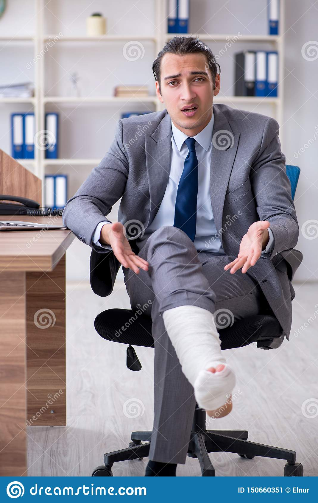 The leg injured male employee in the office