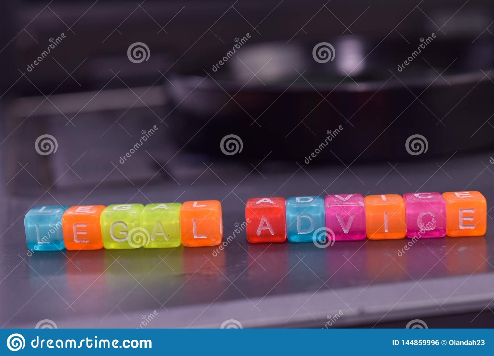 Legal Advide on wooden blocks. Cross processed image with business concept on laptop background