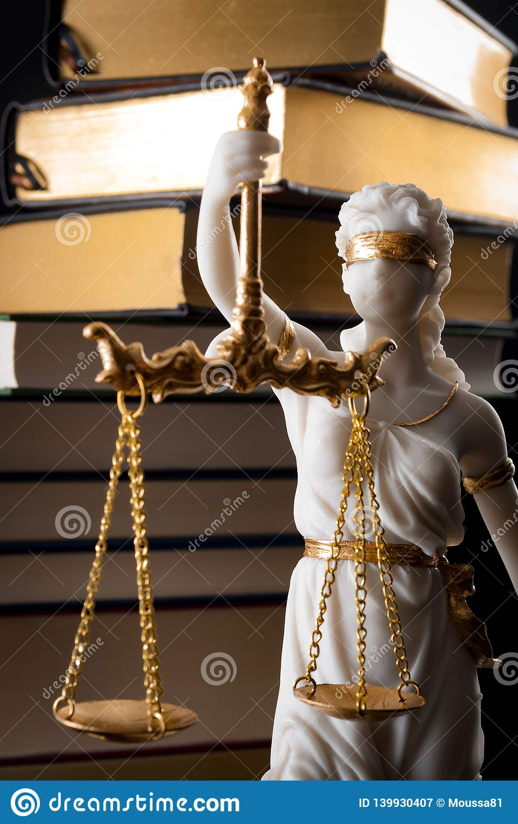 Legal code, enforcement of the law and blind Iustitia concept with statue of the blindfolded lady justice in Greek and