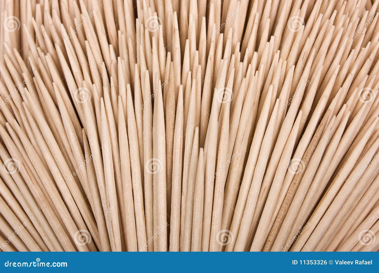 Legno di bianco dei toothpicks isolato priorità bassa