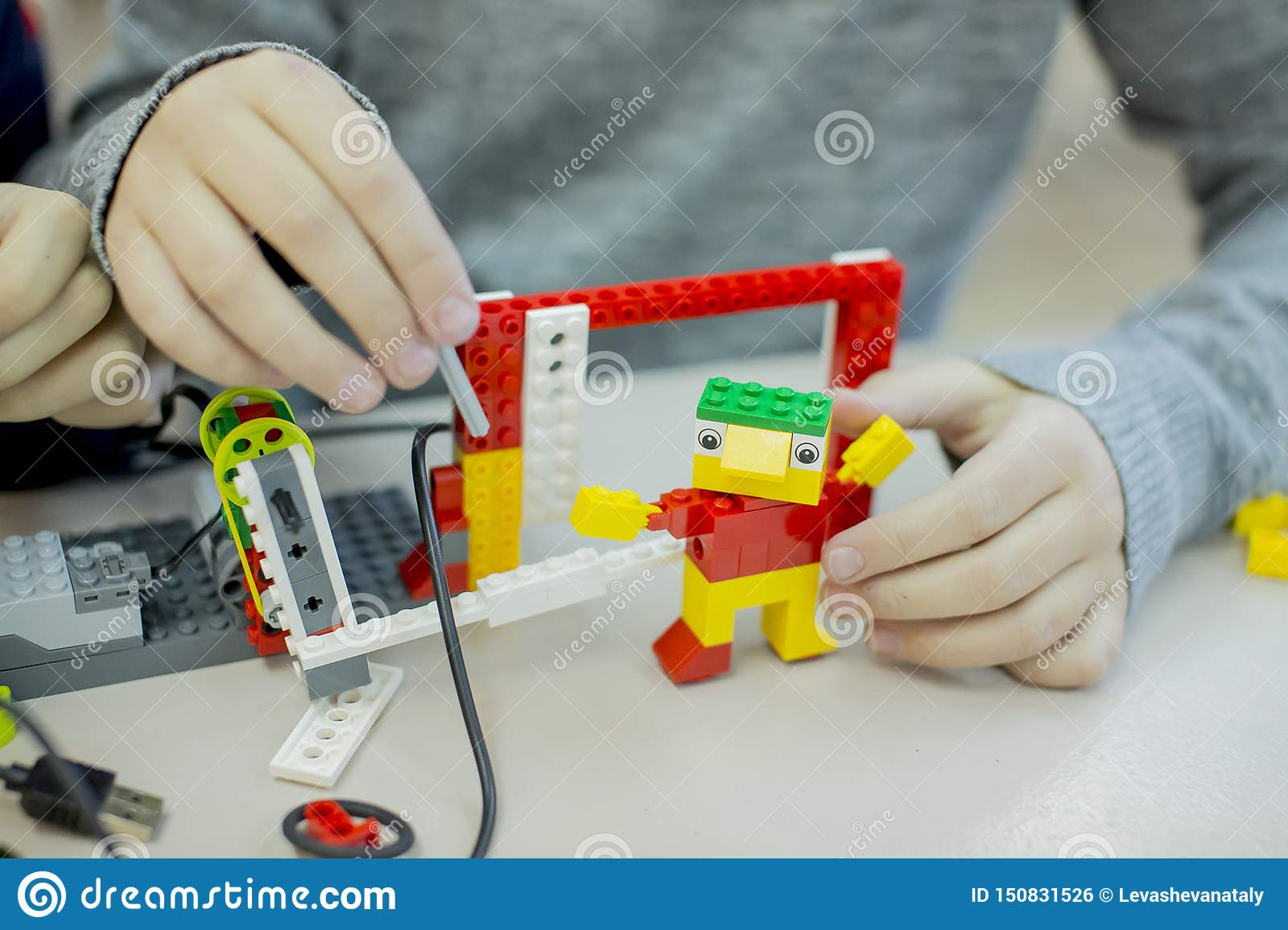 Lego-design circle in high school, children assemble models from the designer
