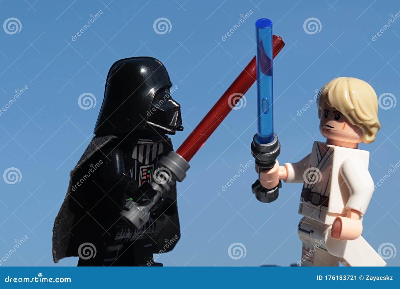 lego star wars figures luke skywalker darth vader fighting lightsabers blue skies background morning sunshine 176183721
