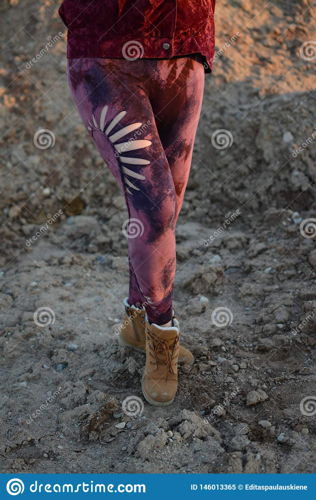Legs in beautiful and unique cut out tights, festival fashion, golden hour, warm evening