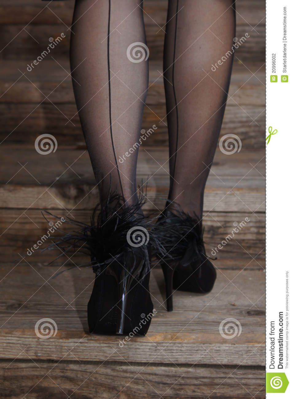 cb5bb4957ae Legs With Black Stockings And Feather Heels Stock Photo - Image of ...