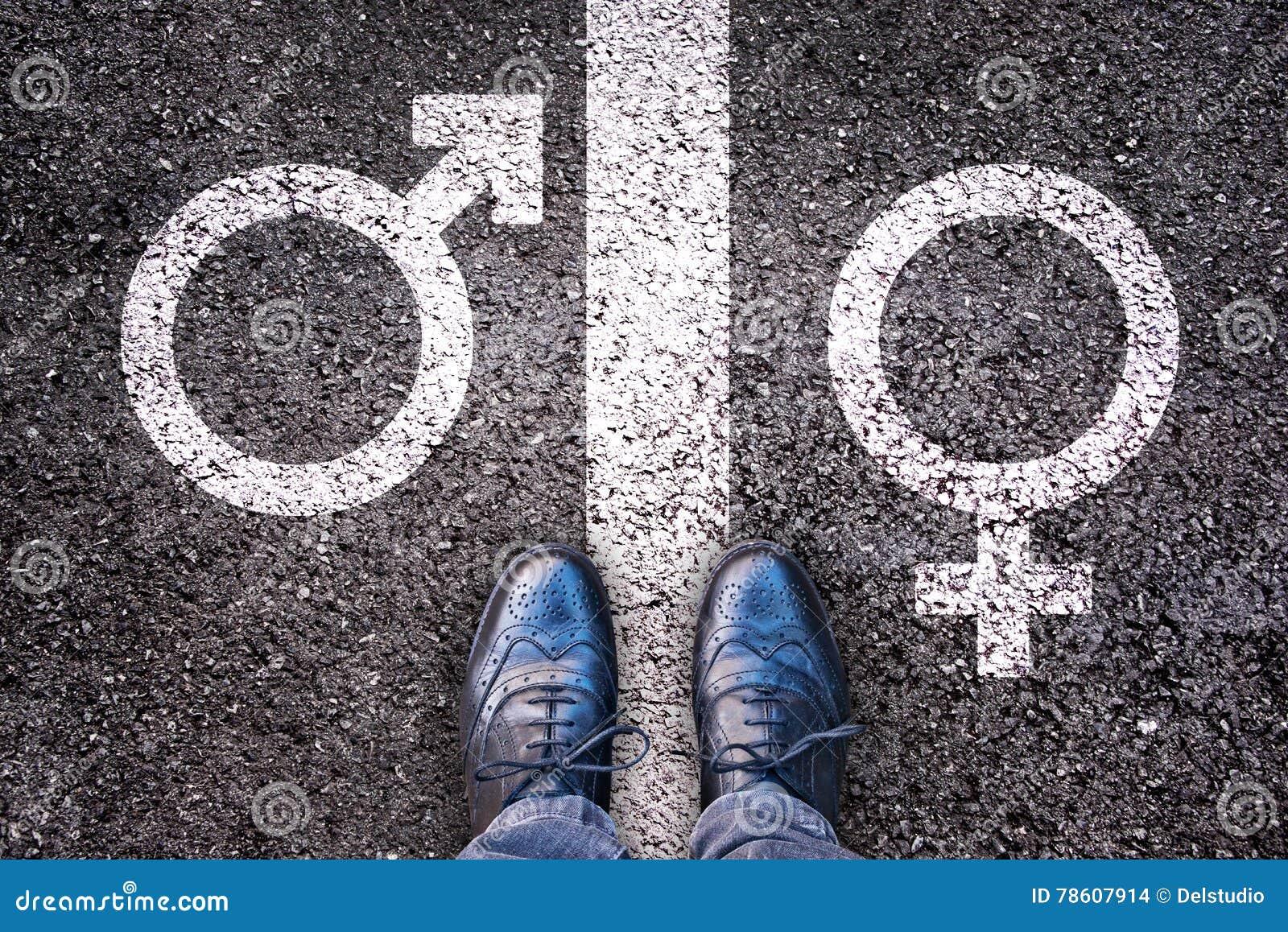 Legs with gender symbol on asphalt