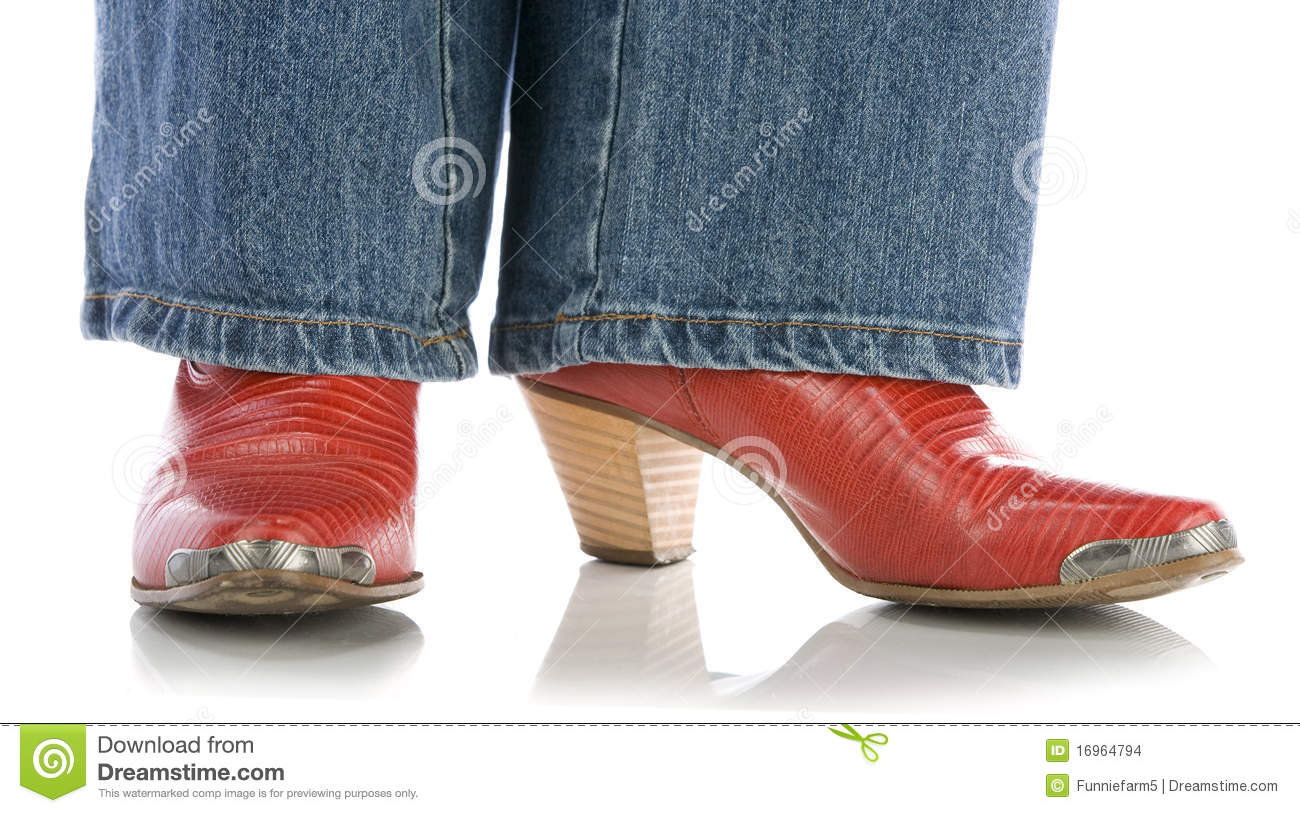 Legs In Jeans Wearing Red Cowboy Boots On White Stock ...