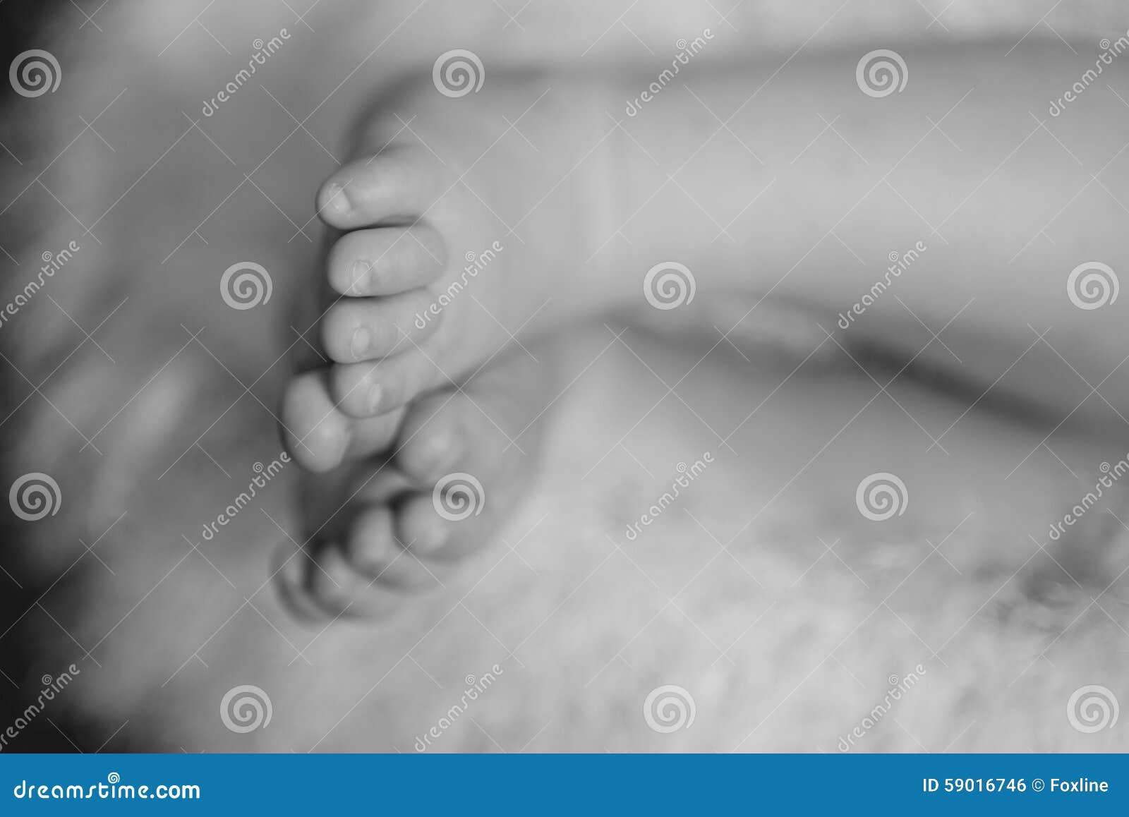 Legs a little baby in basket Legs
