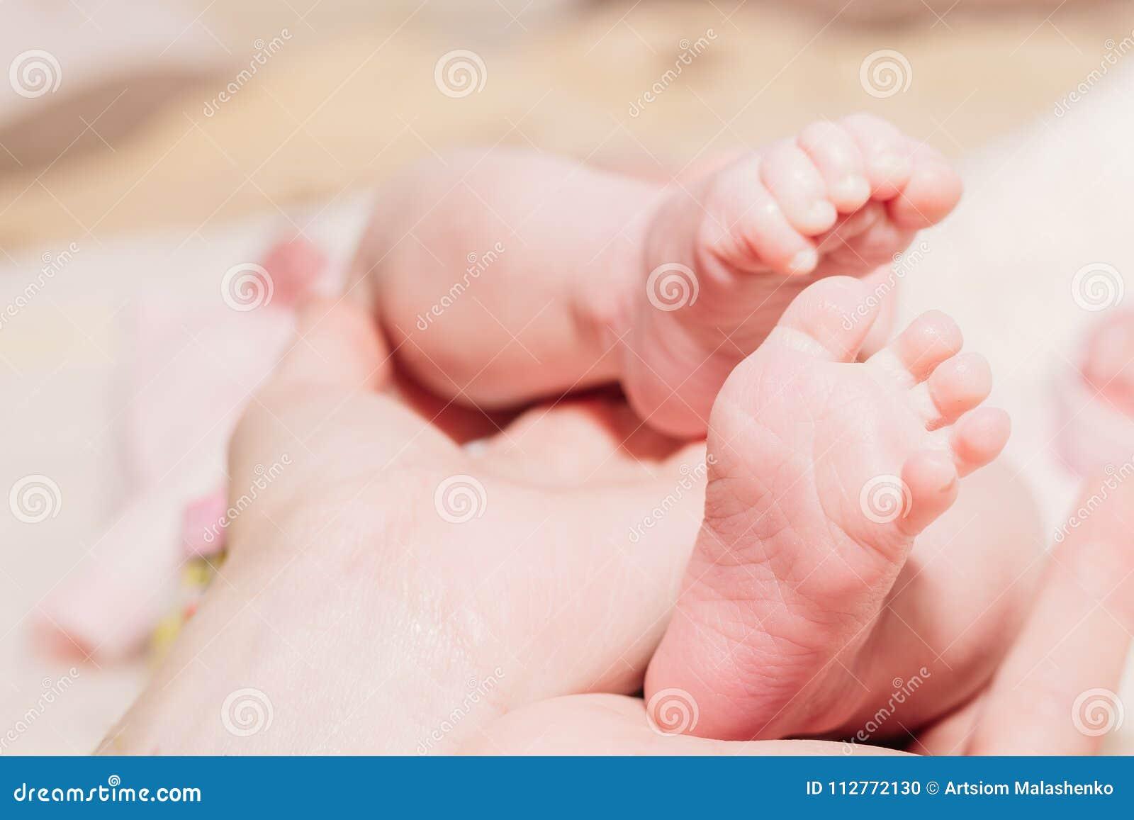 Beautiful legs of a newborn baby closeup
