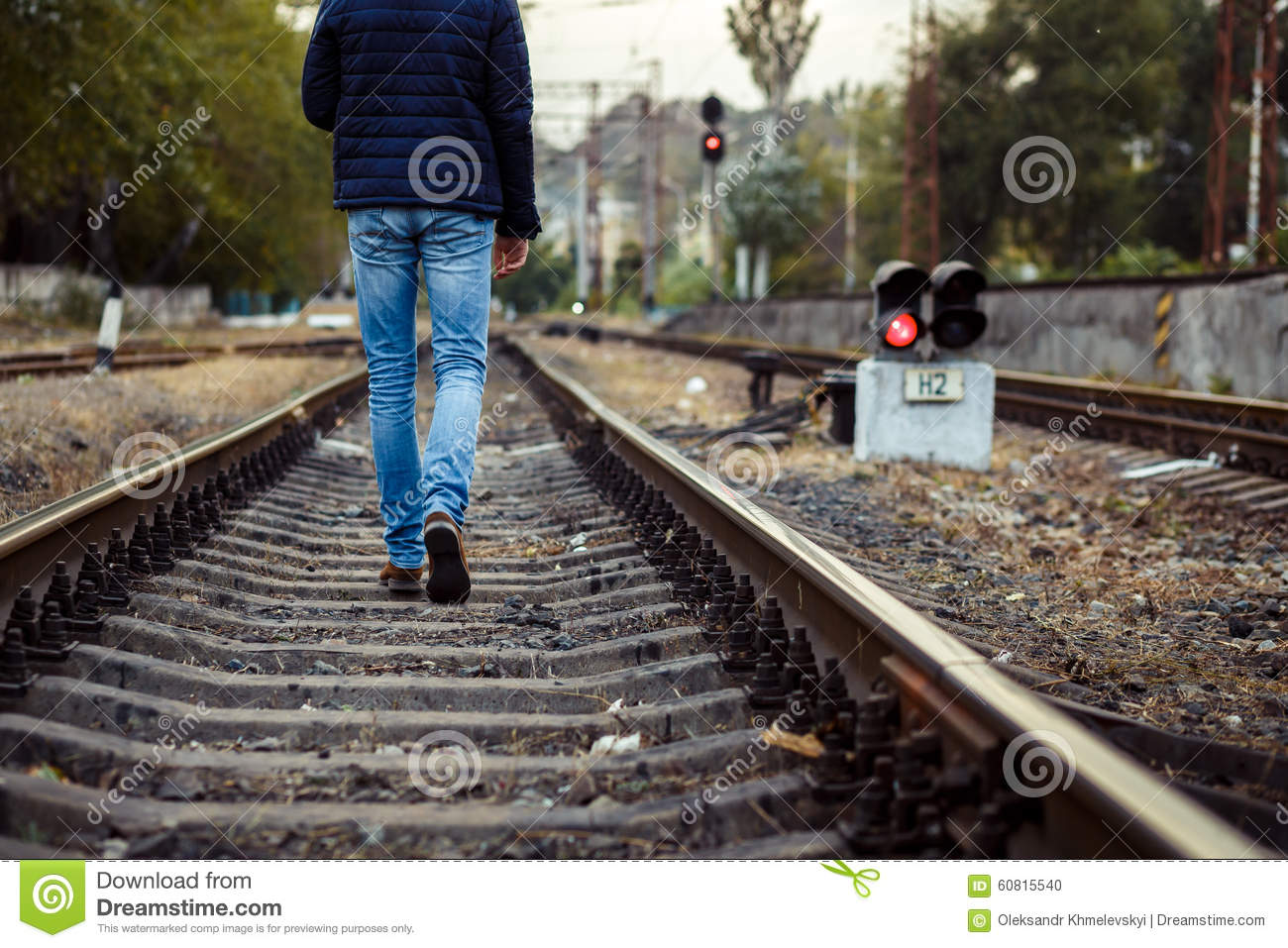 Legs Of Person Walking On Train Tracks Stock Photo - Image: 60815540