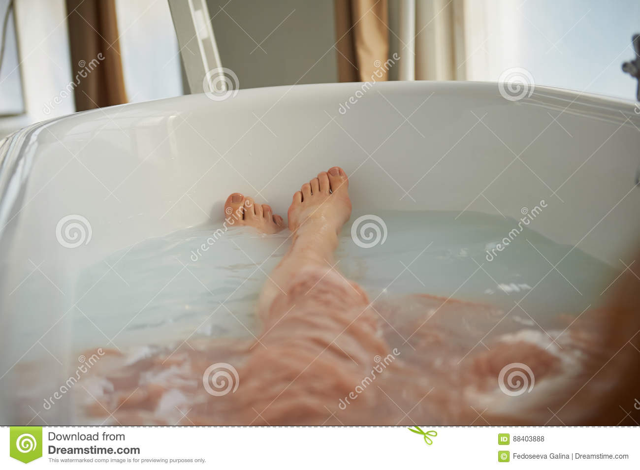 Legs Resting In The Tub Of A Person. Cleopatra Bath With Milk ...