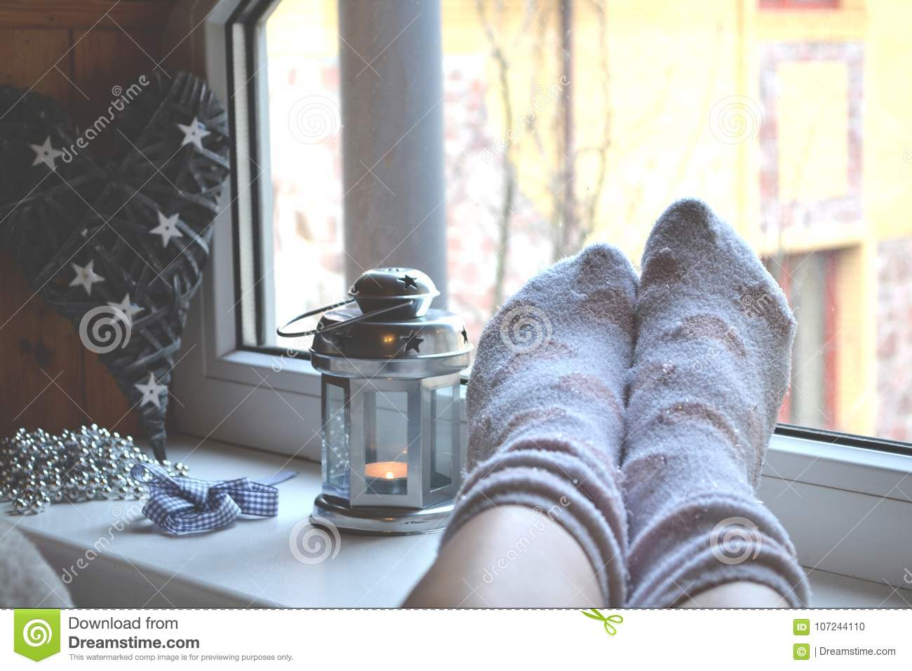 Woman Relaxing At Home Near The Window Decor In Living