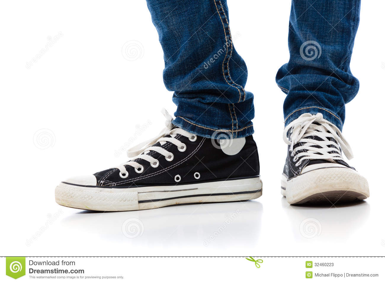 Legs With Tennis Shoes And Jeans Stock Photos - Image: 32460223