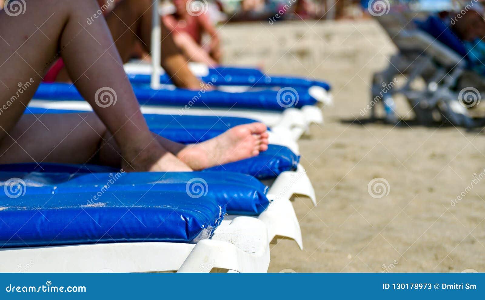 Legs on tropical beach